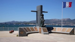 Monument to the dead submariners with the French flag on the seashore Stock Footage
