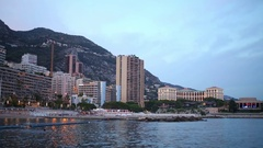 Cityscape with buildings on the seafront and mountains in Monaco Stock Footage