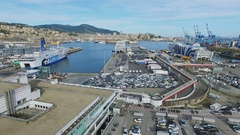 Panorama of Passengers Port with many cars near ferry boats and cityscape Stock Footage