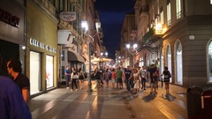 Pedestrian street Via Giacomo Matteotti in the town center at night Stock Footage