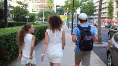 Mother with two children walking down the street in Cannes Stock Footage