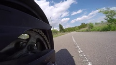 Motorcycle rear wheel tire view through track corners with go pro Stock Footage
