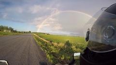 Motorcycle helmet cam looking at rainbow Stock Footage