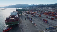 Mooring of ship with support of tugboats near container terminal Stock Footage