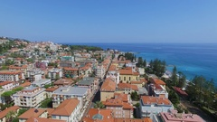 Bordighera, Italy,Townscape with church of Holy Land among houses Stock Footage