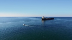 Oil tanker of Palmali company sails in sea at summer sunny day Stock Footage