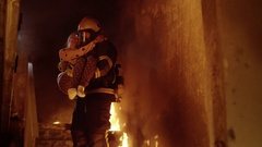 Burning Building. Group Of Firemen Descend on Burning Stairs.  Stock Footage