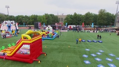 Playgrounds for kids on North Sport Field and tribunes with spectators Stock Footage