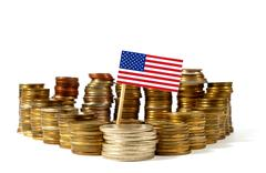 US American flag waving with stack of money Coins Kuvituskuvat