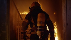 Brave Firefighter Runs Up The Stairs. In Slow Motion. Raging Fire Everywhere Stock Footage