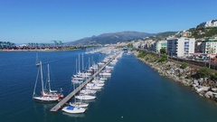 Many boats on moorage in tourist landing marina Castelluccio Stock Footage