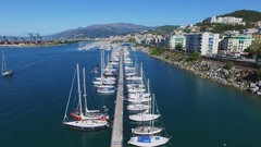 Lot of yachts on moorage in tourist landing marina Castelluccio Stock Footage