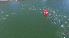 Lot of swimmers make first turn during triathlon contest Stock Footage