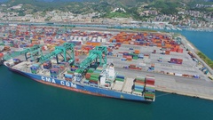 Container terminal Voltri Europa with vessels under cranes Stock Footage