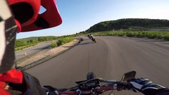Supermoto helmet cam track corner with other riders Stock Footage