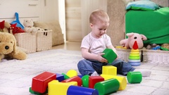 Child playing with color blocks Stock Footage