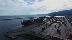Vessel on moorage near crane of Voltri Terminal Europa at summer Stock Footage
