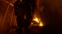 Brave Fireman Runs Up the Burning Stairs. Fire is Everywhere. In Slow Motion. Stock Footage