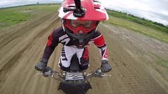 Dirt bike helmet cam big jump slow motion Stock Footage