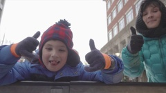 Mother and Son Smiling Together at Outdoor Ice Skating Rink Stock Footage