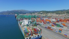 Loading of vessel in Voltri Terminal Europa near coastal city Stock Footage