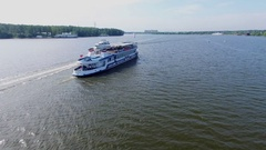 Ivan Kalita touristic ship moves by river with some boats at summer Stock Footage