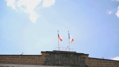 Waving flags of Russia and Velikiy Novgorod in sky Stock Footage
