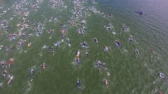Crowd of sportsmen swim during triathlon contest Stock Footage