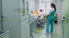 Pair of women work in laboratory of Criminalistical Experts Center. Stock Footage