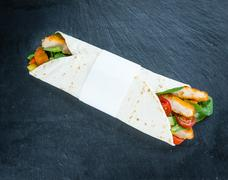 Slate slab with Chicken Wraps (selective focus) Stock Photos