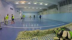 Several men play football in gym of Olympiysky sports complex. Stock Footage