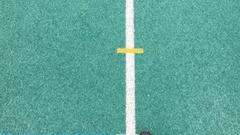 Man walks on high school track - POV Angle Stock Footage