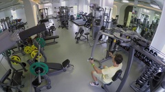 Man makes exercises on training devices in gym. Timelapse Stock Footage