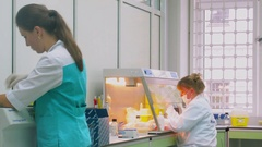 Two women work in laboratory of Criminalistical Experts Center. Stock Footage