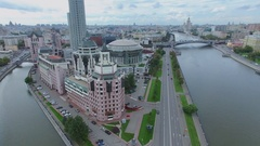 City panorama with traffic on bridge and quay near business center Stock Footage
