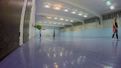 People warmup before football play in gym of Olympiysky sports complex Stock Footage