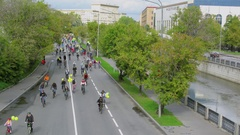 Crowd of bicyclists ride by embankment of Yauza river Stock Footage