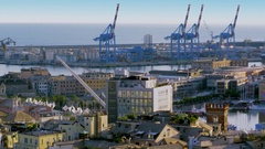Genoa, Italy, Townscape with cranes in sea port at summer day. Stock Footage