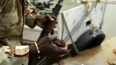 A soldier charging his weapon, detail. Stock Footage