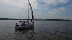 Family travel by river on boat with sails at sunny summer day. Stock Footage