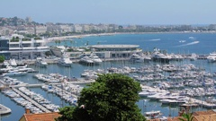 City panorama with traffic on embankment near Cannes Old Port Marina Stock Footage