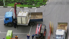 Workers setup equipment for horizontal drilling on street at summer Stock Footage