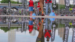 Puddle with reflection of sportsmen during triathlon contest Stock Footage