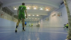 People play football in gym of Olympiysky sports complex Stock Footage