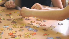 Two preschool girls play a game collecting puzzles Stock Footage