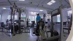 Fitness training of man in gym of sport club. Timelapse Stock Footage