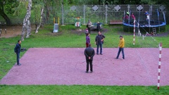 People play petanque game on volleyball playground. Timelapse Stock Footage