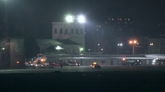 Airport traffic. The airport car accompanies the landing plane Stock Footage