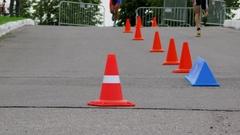 Legs of sportsmen which run around cones during triathlon championship Stock Footage