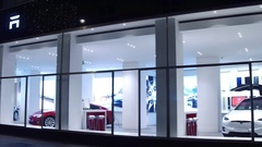 VIENNA, AUSTRIA - DECEMBER, 24 Steadicam shot of innovative Tesla showroom at Stock Footage